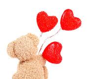 Το Teddy αντέχει με τα κόκκινα μπαλόνια Στοκ φωτογραφία με δικαίωμα ελεύθερης χρήσης