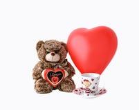 Το Teddy αντέχει με την καρδιά σοκολάτας Στοκ Εικόνες