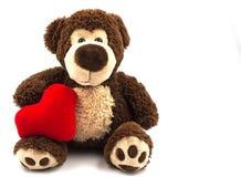 Το Teddy αντέχει με την κόκκινη καρδιά Στοκ Εικόνες