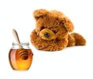 Το Teddy αντέχει με το βάζο μελιού Στοκ φωτογραφία με δικαίωμα ελεύθερης χρήσης