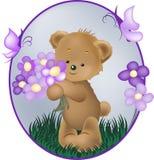 Το Teddy αντέχει με το πορφυρό λουλούδι ελεύθερη απεικόνιση δικαιώματος