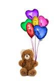 Το Teddy αντέχει τα ζωηρόχρωμα διαμορφωμένα καρδιά μπαλόνια Στοκ Εικόνα