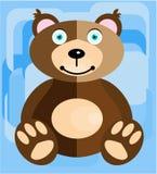 Το Teddy αφορά ένα μπλε υπόβαθρο Στοκ Εικόνες