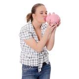 τράπεζα η φιλώντας piggy γυναίκ Στοκ εικόνες με δικαίωμα ελεύθερης χρήσης
