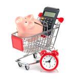 Τράπεζα και υπολογιστής Piggy στο κάρρο αγορών Στοκ Εικόνα