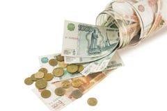 Τράπεζα με τα χρήματα, τα δολάρια, τα ευρώ και τα διεσπαρμένα νομίσματα Στοκ Φωτογραφίες