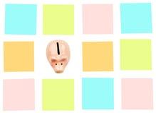 Τράπεζα Piggy με τις ζωηρόχρωμες αυτοκόλλητες ετικέττες Στοκ Φωτογραφία