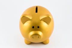 Τράπεζα Piggy στο χρυσό χρώμα Στοκ φωτογραφία με δικαίωμα ελεύθερης χρήσης