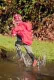 τρέξιμο λακκούβας αγορι Στοκ εικόνα με δικαίωμα ελεύθερης χρήσης