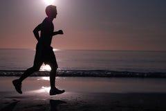 τρέχοντας ηλιοβασίλεμα Στοκ Φωτογραφίες