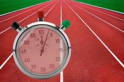 Τρέχοντας διαδρομές και χρονόμετρο με διακόπτη Στοκ Εικόνα
