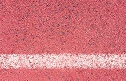 Τρέχοντας διαδρομή με την άσπρα σύσταση και το υπόβαθρο γραμμών Στοκ Εικόνα