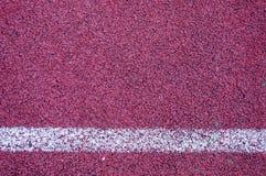 Τρέχοντας διαδρομή με την άσπρη σύσταση γραμμών Στοκ εικόνα με δικαίωμα ελεύθερης χρήσης