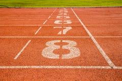 Τρέχοντας διαδρομή με τον αριθμό Στοκ Φωτογραφία