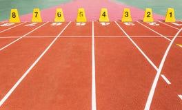 Τρέχοντας διαδρομή με τους αριθμούς παρόδων Στοκ Εικόνες