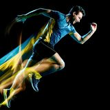 Τρέχοντας jogger jogging απομονωμένο άτομο φως δρομέων που χρωματίζει το μαύρο υπόβαθρο στοκ φωτογραφία με δικαίωμα ελεύθερης χρήσης