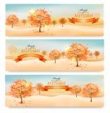 Τρία αφηρημένα εμβλήματα φθινοπώρου με τα ζωηρόχρωμα φύλλα Στοκ Εικόνα