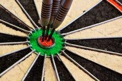Τρία βέλη στο bullseye Στοκ εικόνα με δικαίωμα ελεύθερης χρήσης