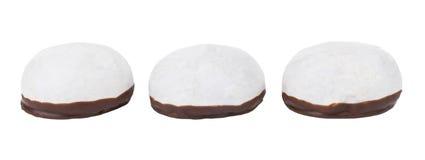 Τρία βερνικωμένα καρύκευμα-κέικ με τη σοκολάτα που απομονώνεται στο λευκό Στοκ Εικόνα