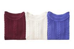 Τρία διπλωμένα πουλόβερ Στοκ φωτογραφία με δικαίωμα ελεύθερης χρήσης