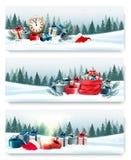 Τρία εμβλήματα Χριστουγέννων τοπίων φύσης με τα κιβώτια δώρων Στοκ Εικόνες
