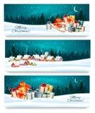 Τρία εορταστικά εμβλήματα Χριστουγέννων με τα τοπία και τα κιβώτια δώρων Στοκ εικόνα με δικαίωμα ελεύθερης χρήσης