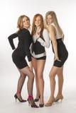 Τρία λεπτά κορίτσια στο άσπρο υπόβαθρο Στοκ Φωτογραφία