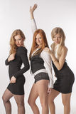 Τρία λεπτά κορίτσια στο άσπρο υπόβαθρο Στοκ Εικόνα