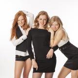 Τρία λεπτά κορίτσια στο άσπρο υπόβαθρο Στοκ εικόνα με δικαίωμα ελεύθερης χρήσης