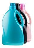 Τρία ζωηρόχρωμα πλαστικά μπουκάλια Στοκ Εικόνες