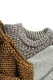Τρία θερμά πουλόβερ που απομονώνονται στο άσπρο υπόβαθρο, κάθετο Στοκ εικόνες με δικαίωμα ελεύθερης χρήσης