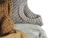 Τρία θερμά πουλόβερ που απομονώνονται στο άσπρο υπόβαθρο, οριζόντιο Στοκ Εικόνες