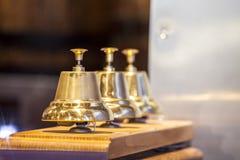 Τρία διακοσμητικά χρυσά κουδούνια Στοκ φωτογραφία με δικαίωμα ελεύθερης χρήσης