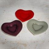 Τρία καρδιά-διαμορφωμένα πιάτα γευμάτων Στοκ εικόνα με δικαίωμα ελεύθερης χρήσης