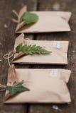 Τρία καφετιά κιβώτια δώρων τεχνών Στοκ Φωτογραφίες