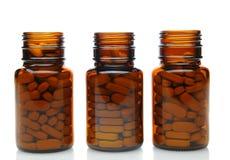 Τρία καφετιά μπουκάλια ιατρικής Στοκ εικόνα με δικαίωμα ελεύθερης χρήσης
