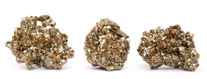 Τρία κομμάτια των χρυσών κρυστάλλων πυρίτη Στοκ Φωτογραφίες