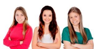 Τρία κορίτσια εφήβων με τα διασχισμένα όπλα Στοκ Εικόνα