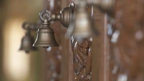 Τρία κουδούνια Ganta στον τοίχο απόθεμα βίντεο