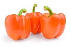 Τρία κόκκινα γλυκά βουλγαρικά πιπέρια που απομονώνονται στο άσπρο υπόβαθρο Στοκ Εικόνες