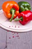 Τρία μικτά πιπέρια Στοκ Εικόνες