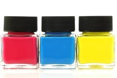 Τρία μπουκάλια με το αρχικό χρώμα χρωμάτων Στοκ Εικόνα
