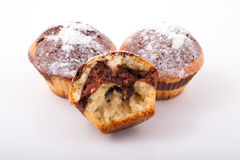 Τρία νόστιμα πρόσφατα ψημένα muffins Στοκ Φωτογραφία
