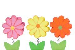 Τρία ξύλινα λουλούδια χρώματος Στοκ Εικόνα