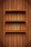 Τρία ξύλινα ράφια στο ξύλινο υπόβαθρο Στοκ Εικόνες