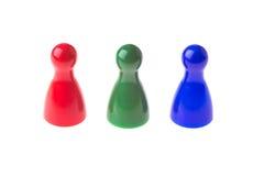 Τρία πιόνια παιχνιδιών Στοκ φωτογραφία με δικαίωμα ελεύθερης χρήσης