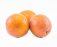 Τρία πορτοκάλια σε ένα άσπρο υπόβαθρο - μπροστινή άποψη Στοκ Εικόνες