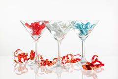 Τρία ποτήρια των εξοπλισμών σαμπάνιας και γκολφ Στοκ εικόνα με δικαίωμα ελεύθερης χρήσης