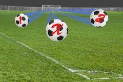 Τρία ποδόσφαιρα που παρουσιάζουν πιθανό τελικό αποτέλεσμα του παιχνιδιού Στοκ Φωτογραφίες
