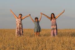 Τρία τεθειμένα κορίτσια χέρια επάνω Στοκ εικόνα με δικαίωμα ελεύθερης χρήσης